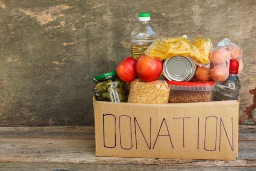 Charitable Giving: Donation box with food.