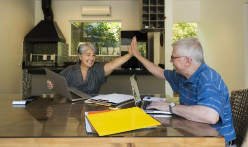 Couple High-Fiving After Tax Planning