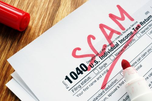 Tax scam. Form with sign on a desk.