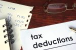 Tax Deductions paper and handwritten calculations