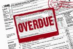 Red overdue stamp on tax form